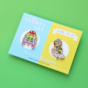 Image of Rainbow Rib cage and skeleton hand / rose, set of TWO enamel pins