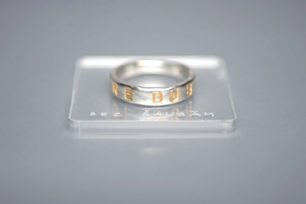 Image of silver classical ring with gold plated letters and inscription in Latin