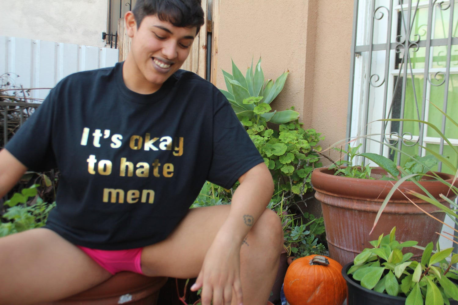 Image of IT'S OKAY TO HATE MEN (Black shirt and shimmery gold print)
