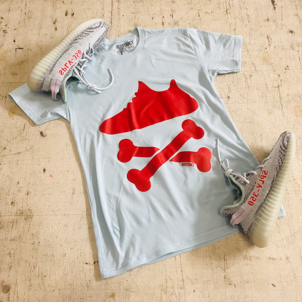 "Image of YEEZY CROSSBONES ""BLUE TINT"" PRINTED T-SHIRT"