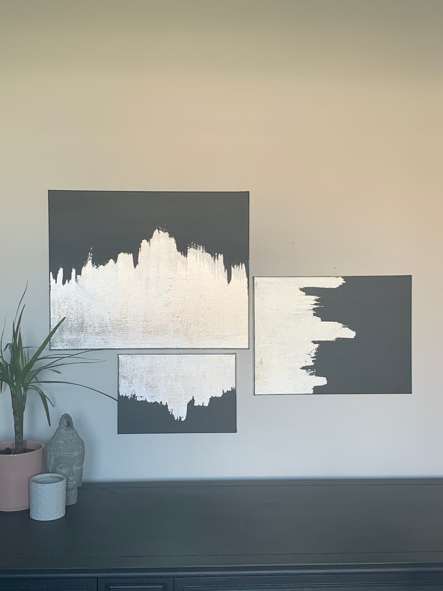 Image of A set of 3 dark grey & silver leaf canvases made by Ethan & Grace's