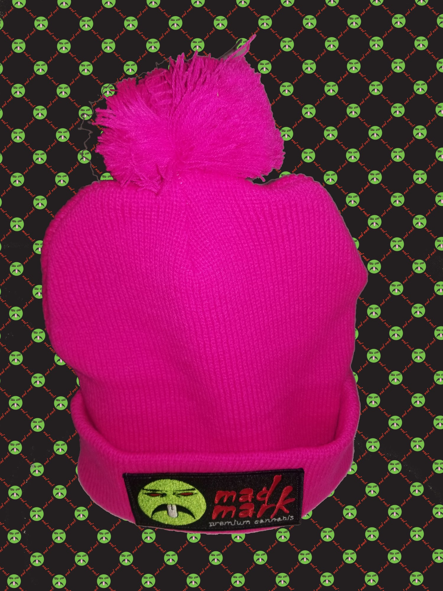 Image of puff ball patched beanie