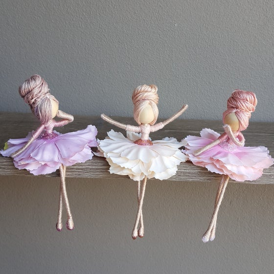 Image of Trio of pastel flower dolls.
