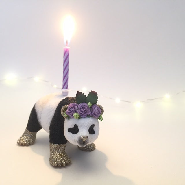 Image of PANDA standing, with flower crown
