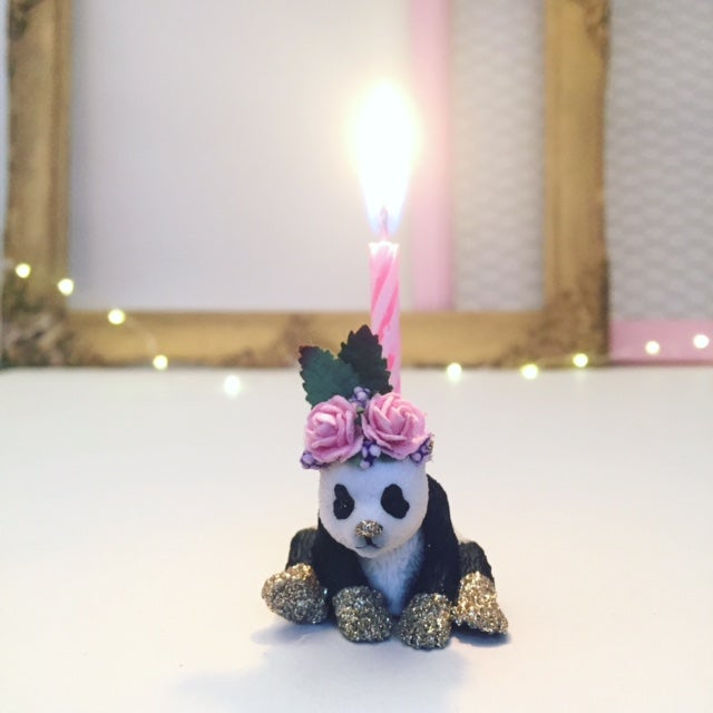 Image of PANDA cub with flower crown