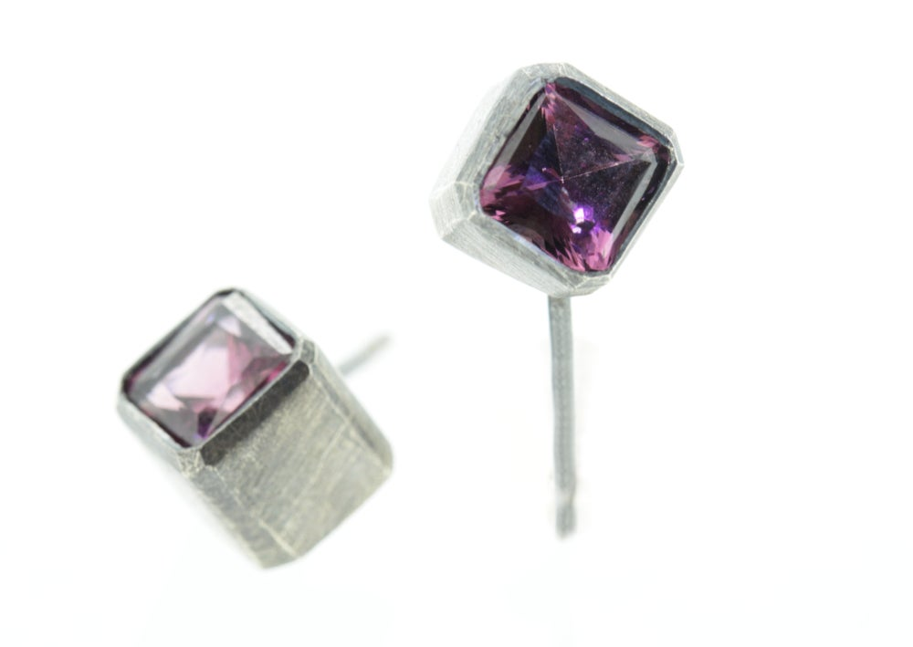 Image of  Oxidised sterling cube studs set Rhodolite Garnets