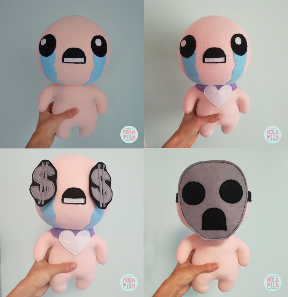 Image of Isaac toy with three accessories.