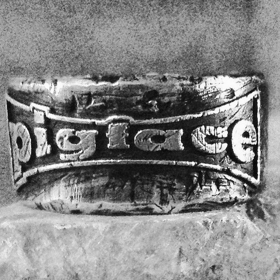 Image of Pigface Sterling Silver Logo Ring by Boneyard Skull Rings