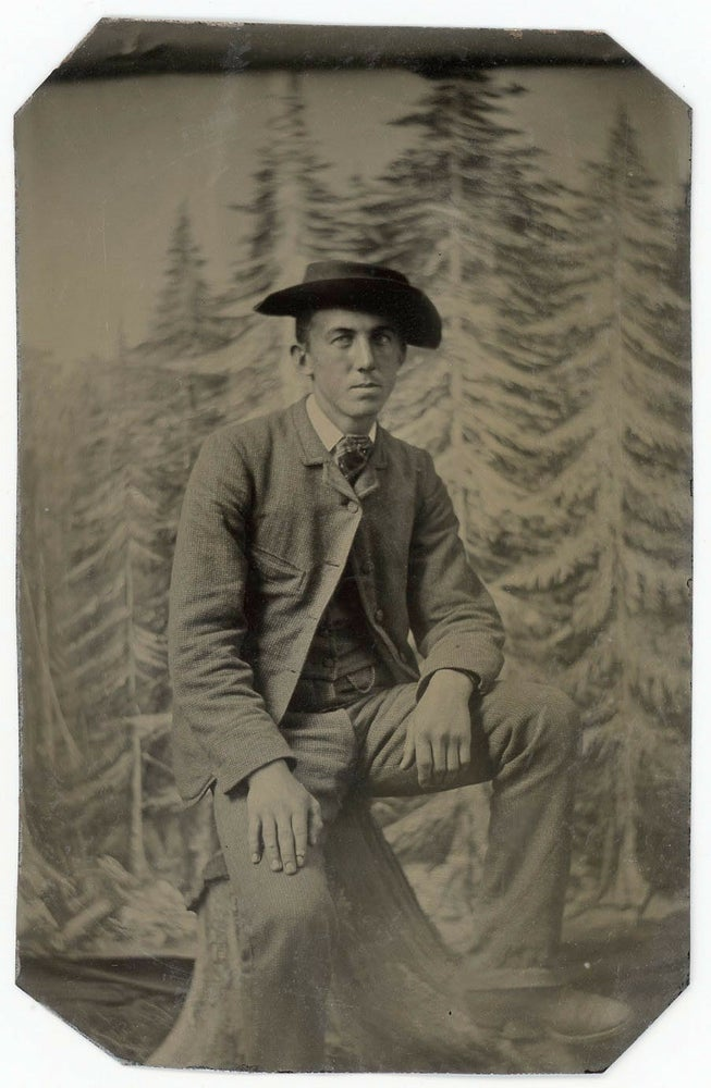 Image of Tintype of a young man, unusual backdrop, ca. 1865