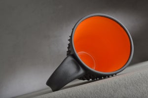 Image of Spiky Mug Gun Metal Black and Orange Made To Order By Symmetrical Pottery