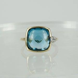 Image of 14ct yellow gold diamond and blue topaz dress ring