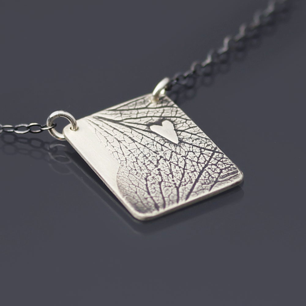 Image of Sterling Silver Hydrangea Petals and Heart Necklace