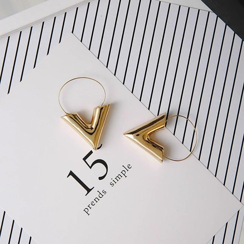 Image of Gold letter V earrings