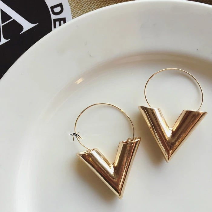 Image of Gold letter V earrings