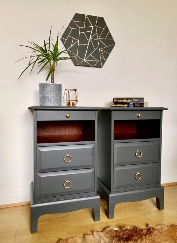 Image of A pair of dark grey stag & mahogany bedside tables