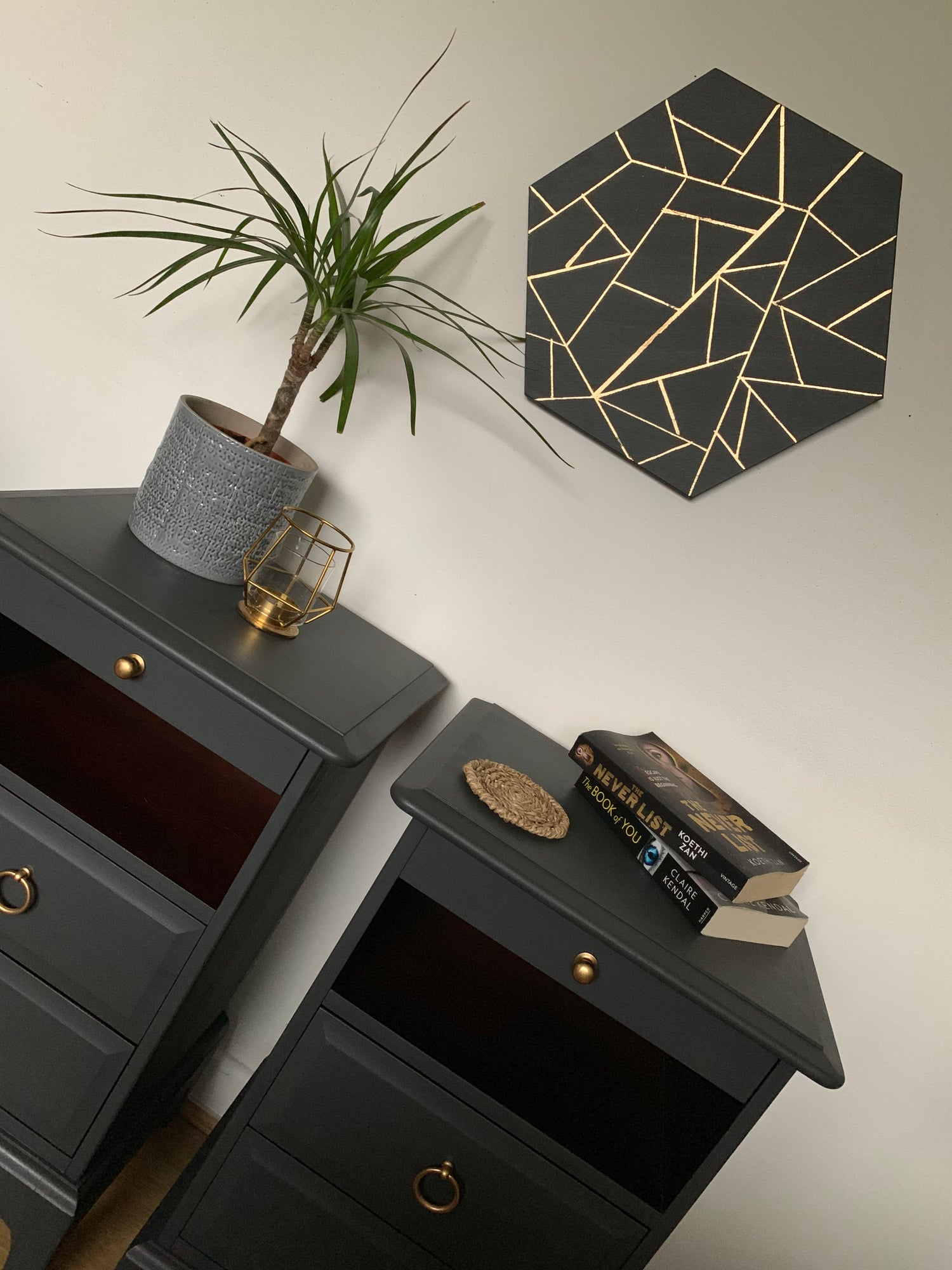 Image of A rare pair of dark grey stag & mahogany bedside tables