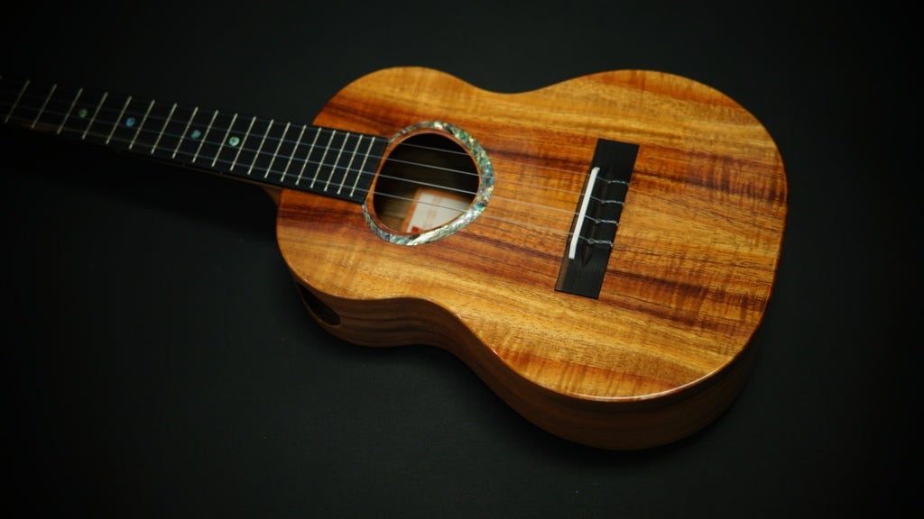 Image of KoAloha Custom Ordered Side Port Curly Koa/Walnut Tenor