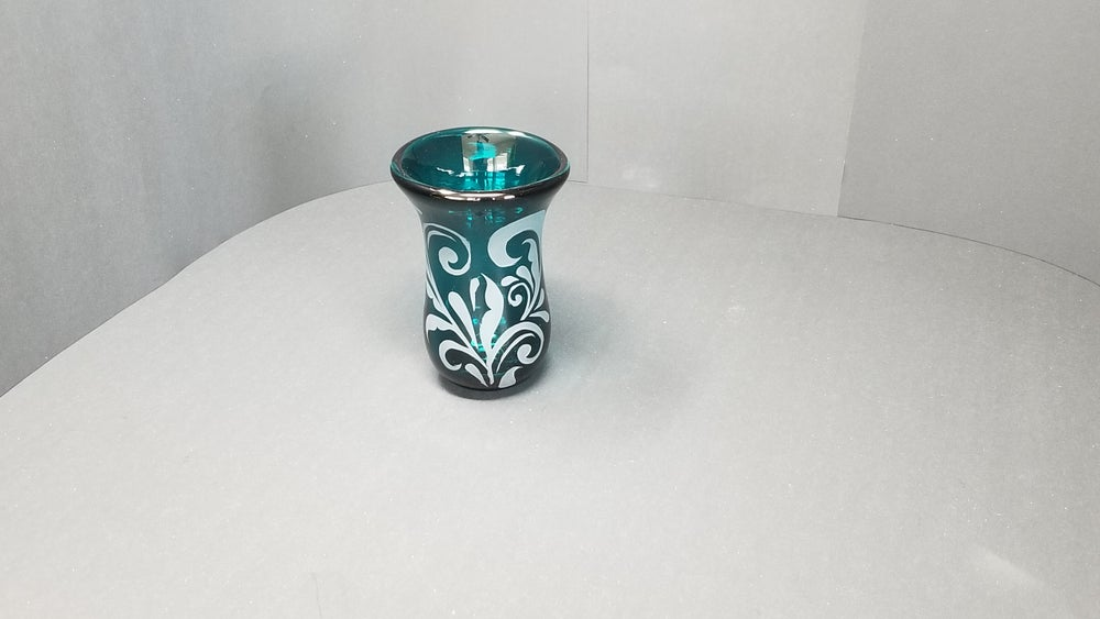 Image of Silver green vase with floral motif