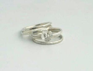 Image of Silver stacking rings with Buttercup flower
