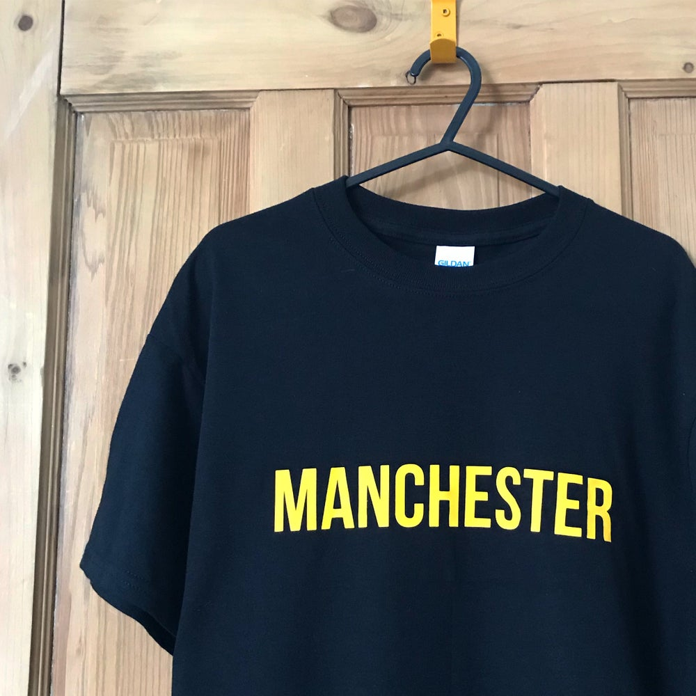 Image of MANCHESTER T-SHIRT IN BLACK + YELLOW