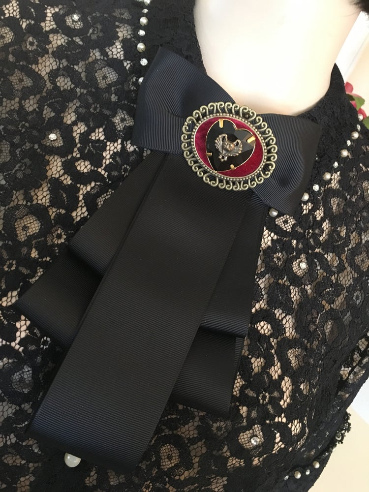 Image of Beautiful Black Ribbon Brooch/Tie With Red Cameo And Black Heart With Bat Face