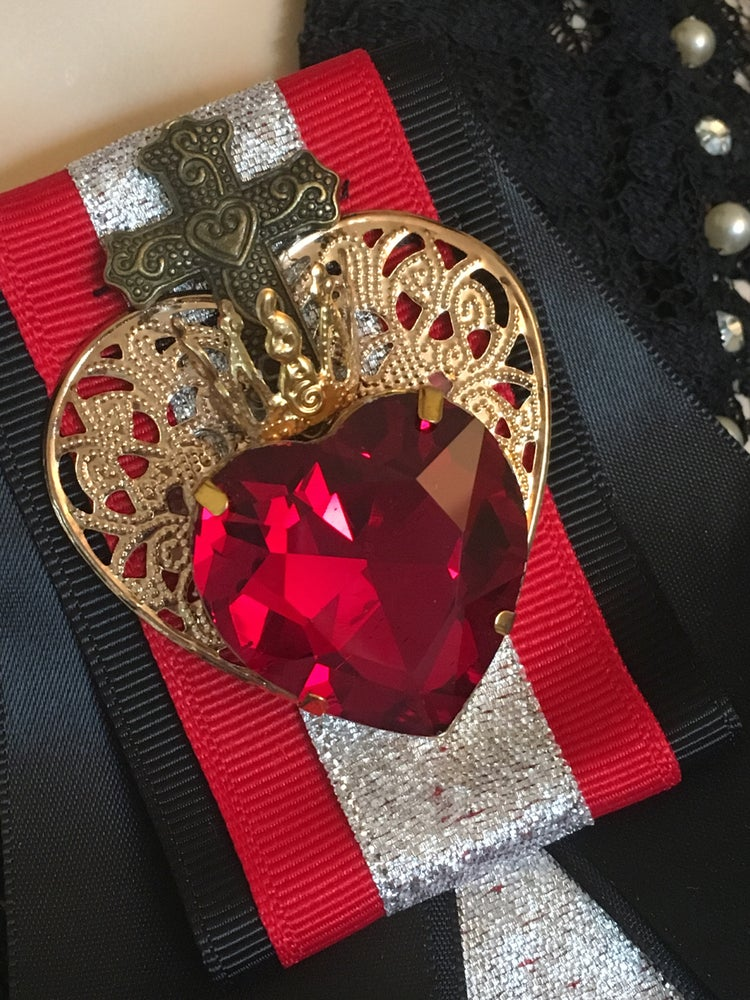 Image of Sacred Heart Brooch Tie With Red, Silver, Black Ribbon