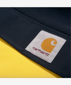 Image of CARHARTT WIP_NIMBUS JACKET (TWO-TONE) :::DARK NAVY/PRIMULA:::