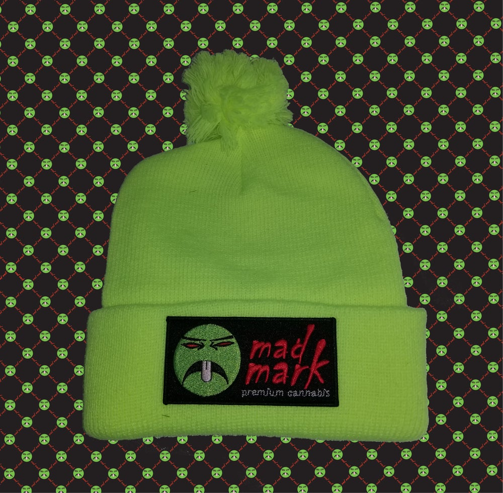 Image of puff ball  patch beanie
