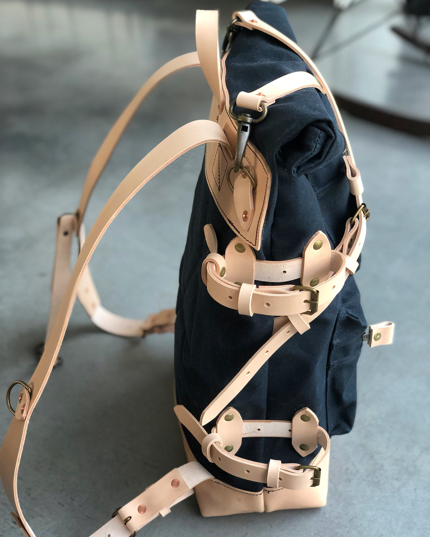 Image of Backpack made in waxed canvas and natural vegetable tanned leather with double zipper pocket