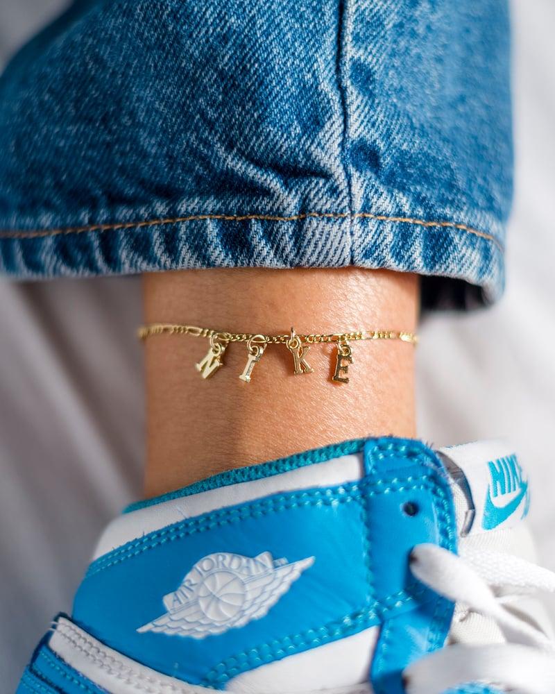 Image of Gold Nike Anklet