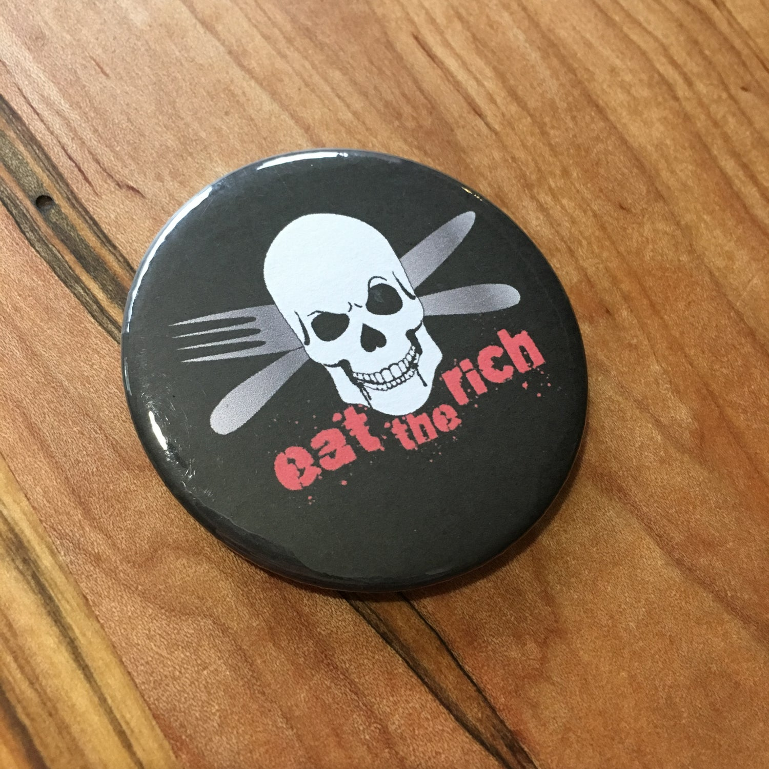 "Image of Eat The Rich Crossed 2.5"" Button"