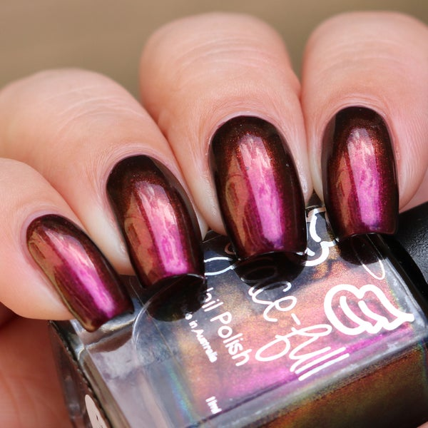 Image of Little Miss Perfect is a multichrome that moves through pink, red and copper.