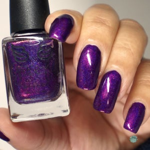 Image of Stan's Wheels -  a vibrant purple holo with a pink flash