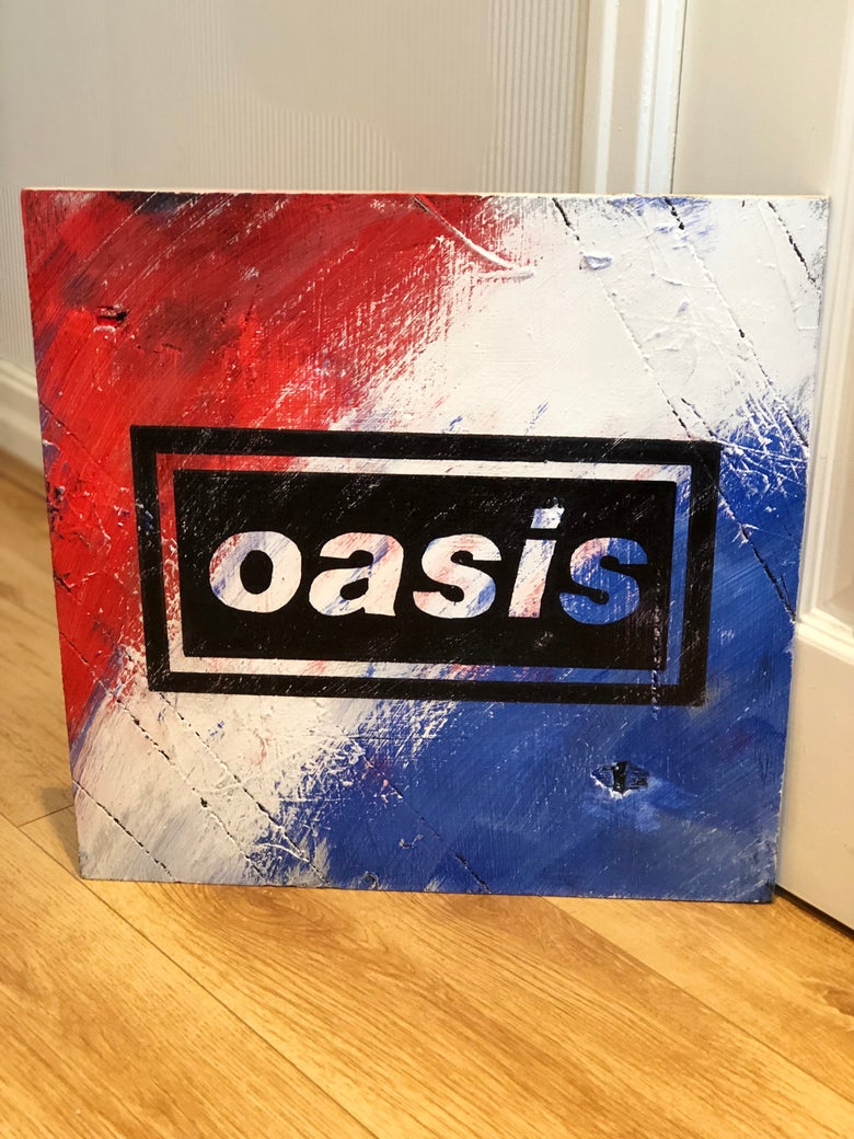 Image of Oasis iconic logo hand painted on wood