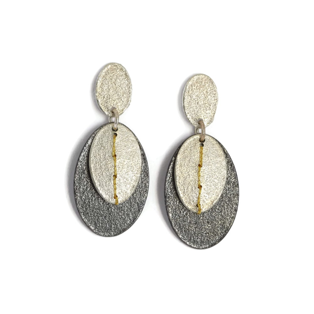 Image of Sewn-up 2-layer dangly earrings