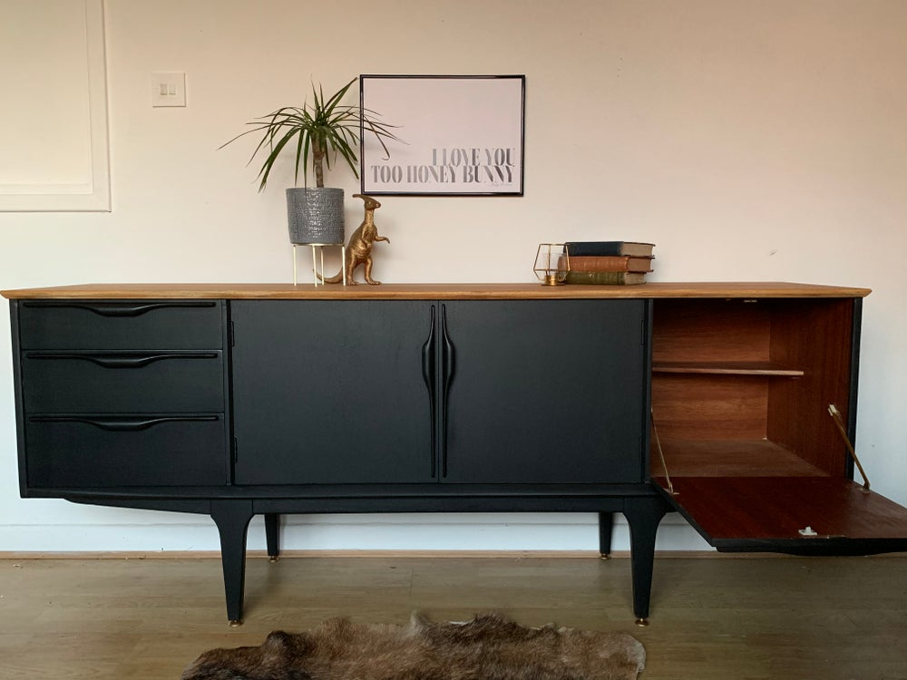 Image of Black Jentique sideboard with a natural teak top.