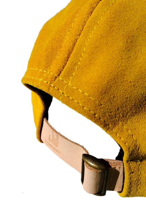Image of mustard suede cap