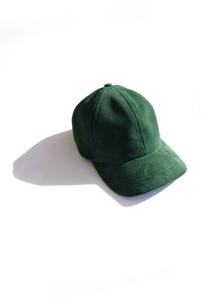 Image of forest green suede cap