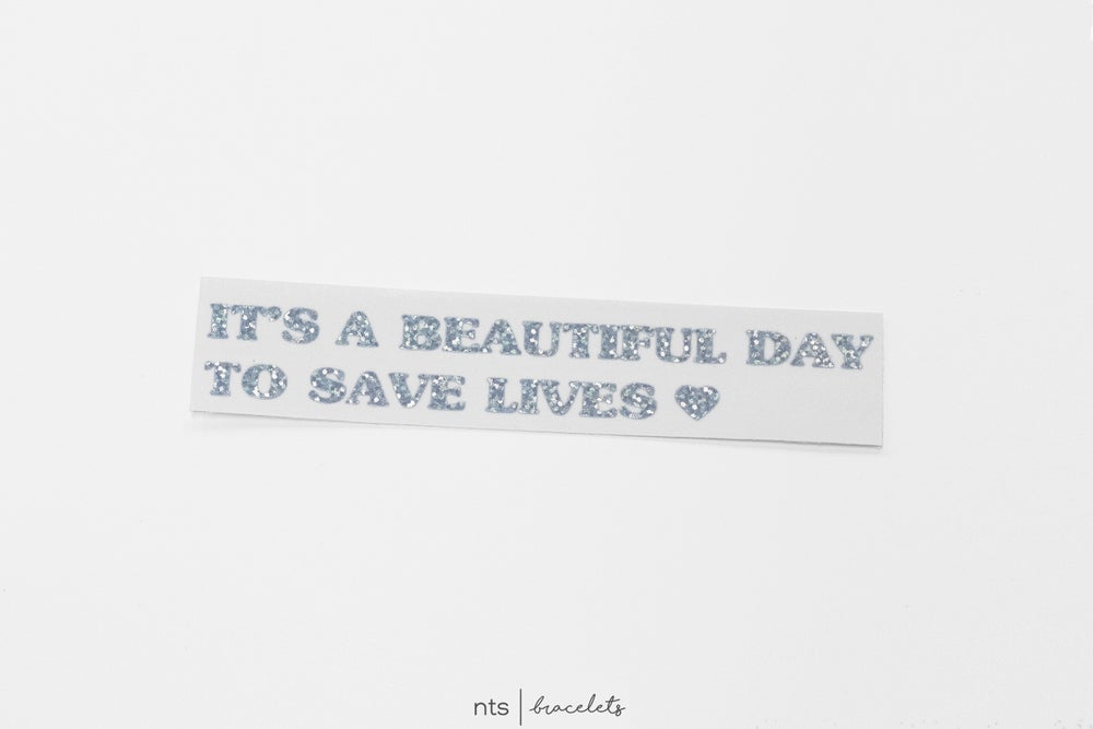 Image of IT'S A BEAUTIFUL DAY TO SAVE LIVES VINYL STICKER (GLITTER)