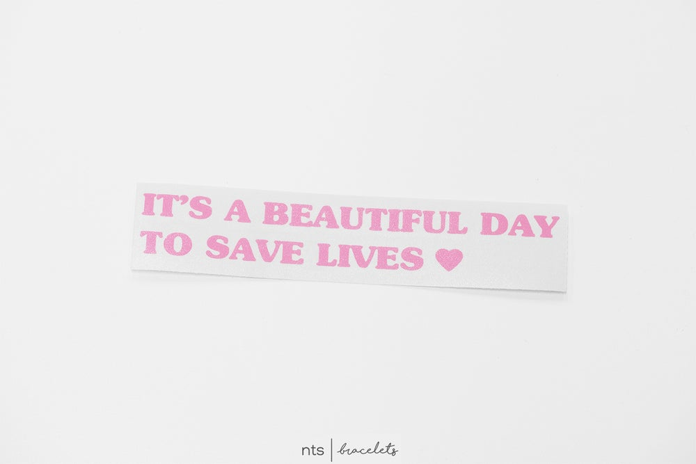 Image of IT'S A BEAUTIFUL DAY TO SAVE LIVES VINYL STICKER (PINK)