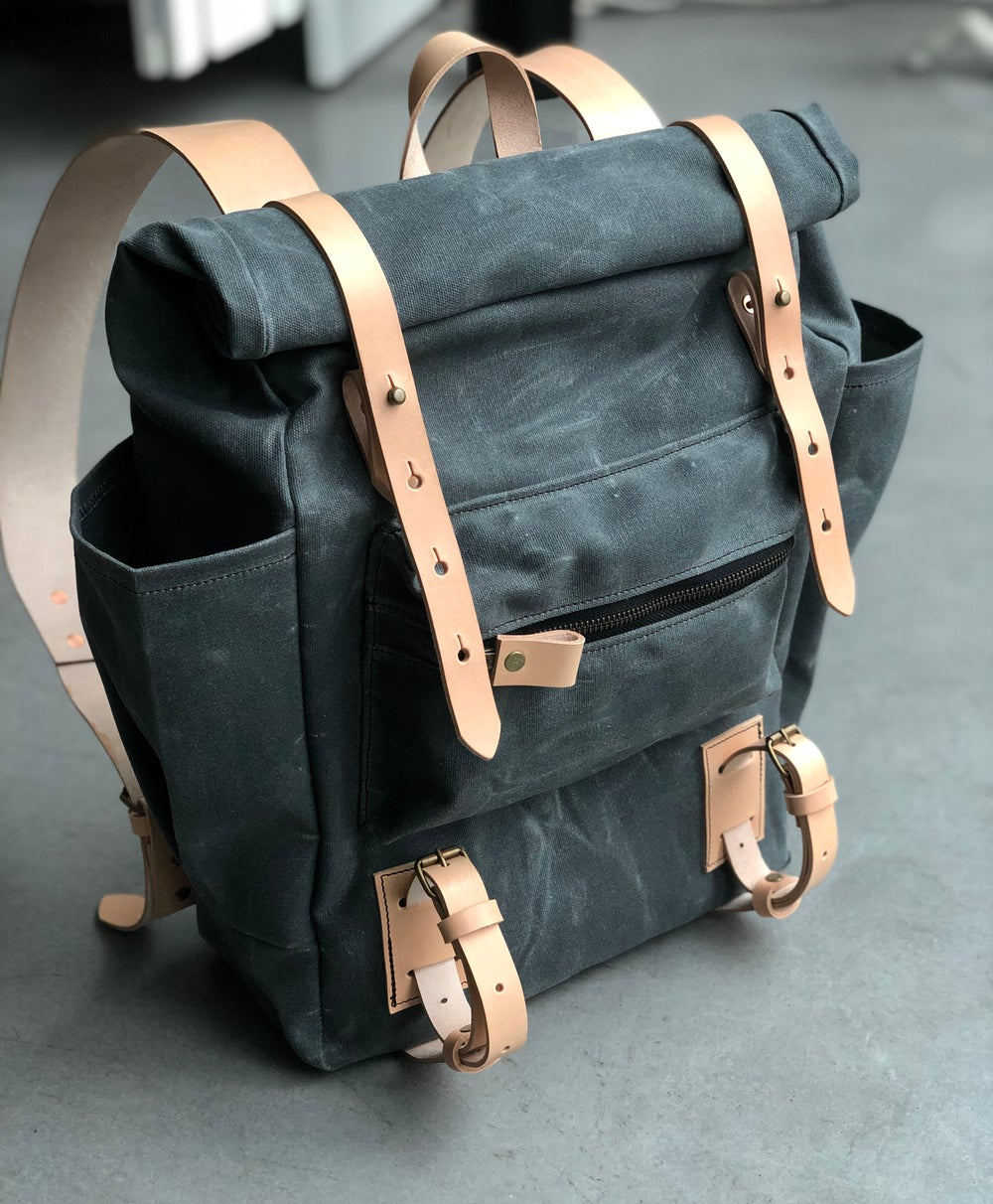 Image of Yoga backpack in waxed canvas with zipper pocket and double yoga straps