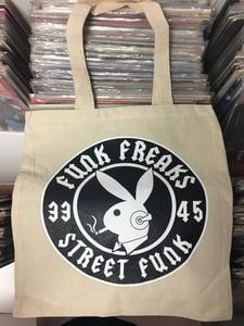 Image of Cream colored tote record bag