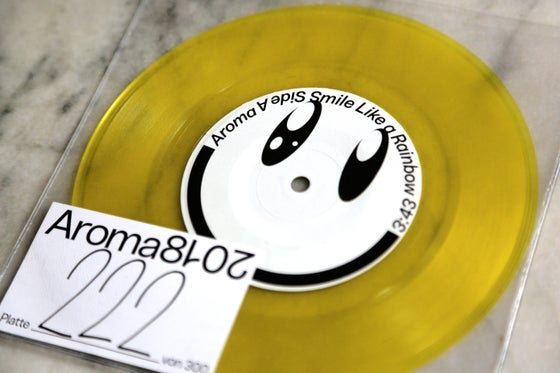Image of Smile Like a Rainbow Colored Single Vinyl