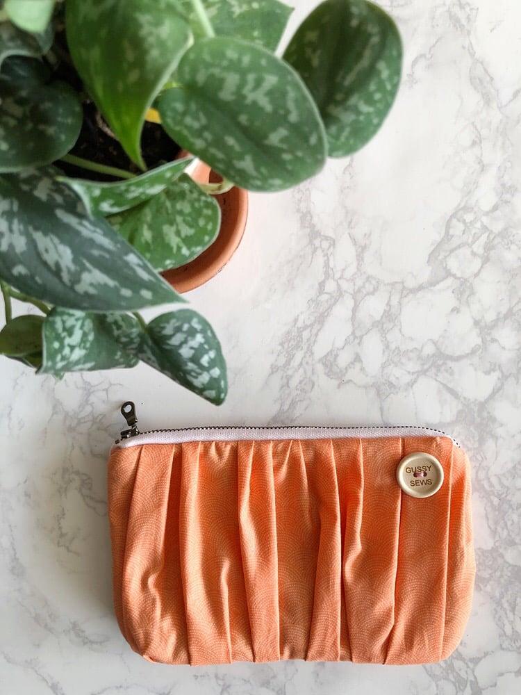 Image of Tangerine Swirl medium zip pouch