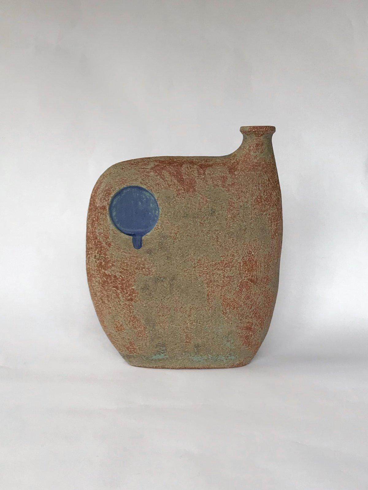 Image of Bottle; Blue Circle