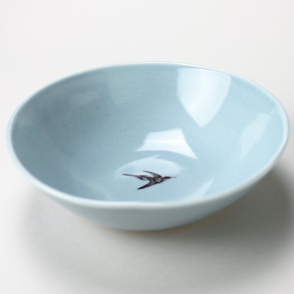 Image of soup bowl with hummingbird, ocean