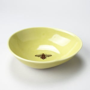 Image of beachstone bowl with bumblebee, mustard