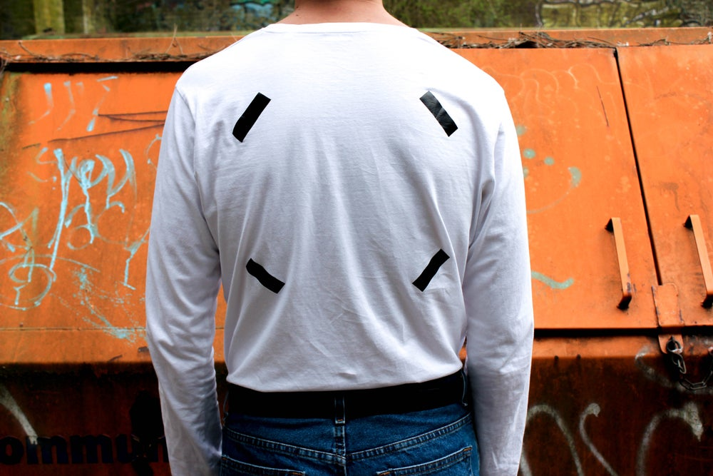 Image of white long-sleeved t-shirt 'FRAME'
