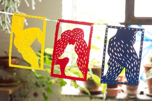 Image of paper cut-out BUM bunting