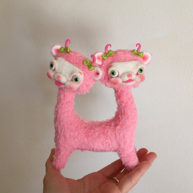 Image of Peaches and Punch the Tiny Two-Headed Yak